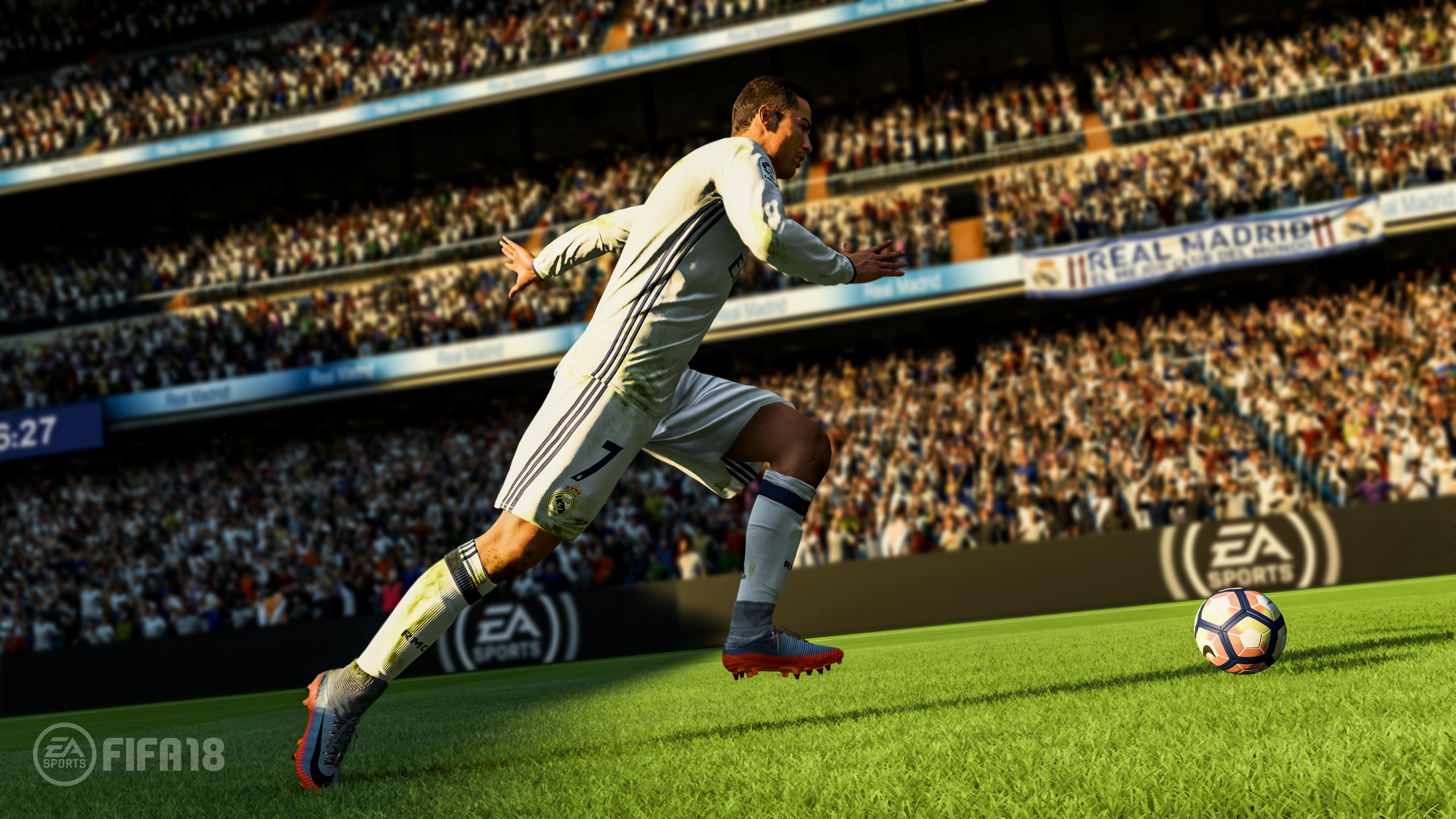 Cristiano Ronaldo sprints with the ball in the FIFA 18 trailer