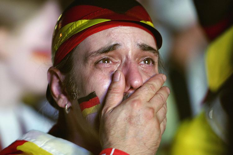 A German fan cries with happiness after drawing England in the next round