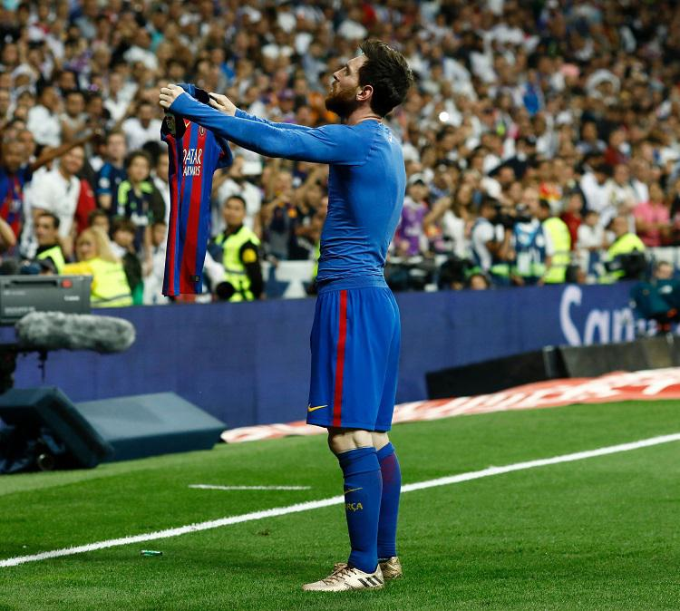 Messi celebrates in front of the home faithful at the Bernabeu