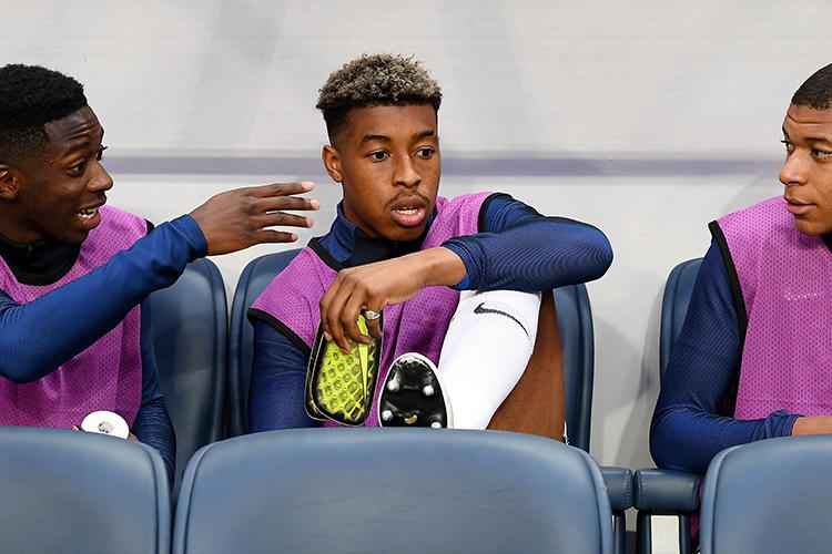 Kimpembe trying to work out if sand is called sand because it's between the sea and the land
