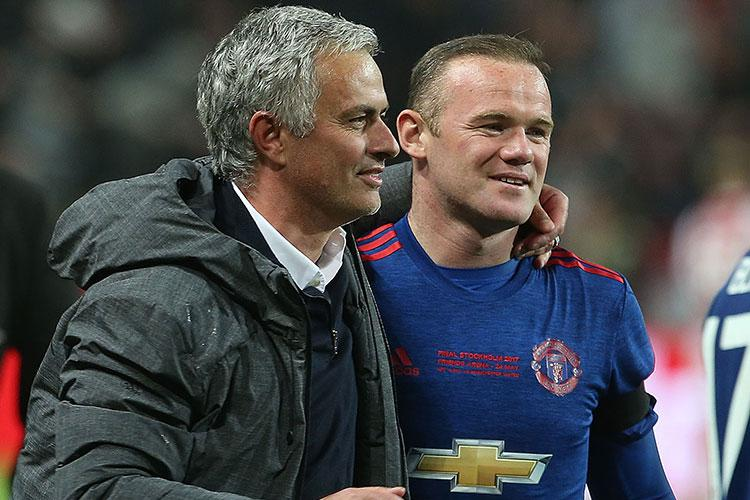 Rooney and Mourinho celebrate their Europa League triumph
