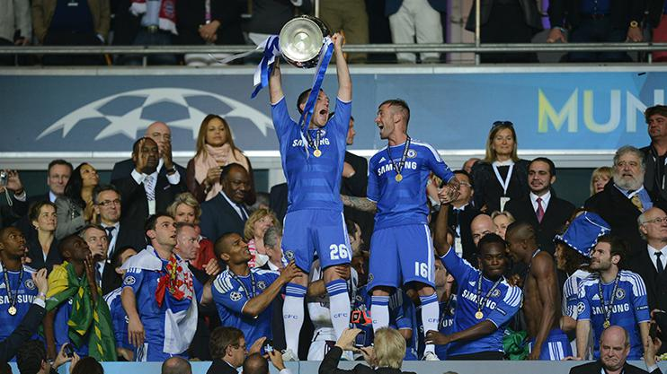 John lifts the Champions League trophy despite not playing