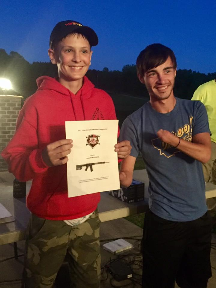 Hunter poses with a pal at a shooting competition