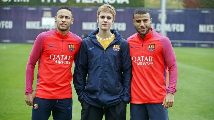 Rafinha and Neymar with a female fan