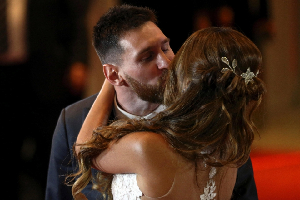 Lionel Messi and Antonella share a kiss after their wedding ceremony