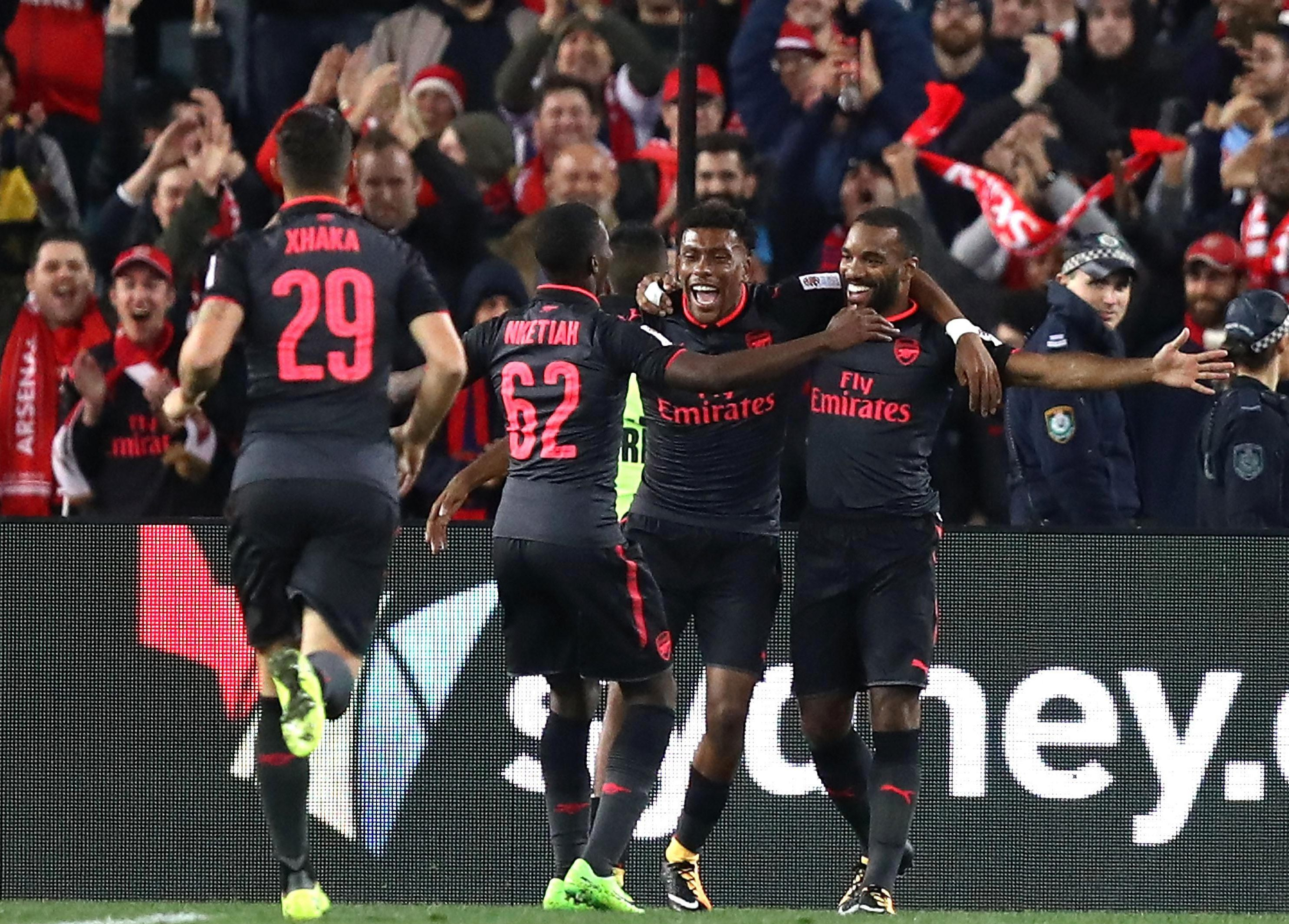 Lacazette celebrates with his new team-mates