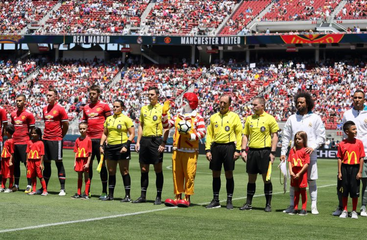 Ronald McDonald (middle with the red hair) prepares to meet the players