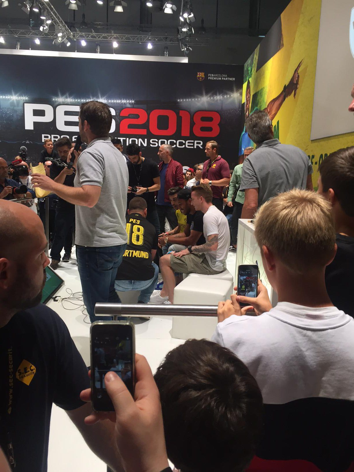 FIFA 17 cover star Reus and his teammate Aubameyang play PES in full view of EA