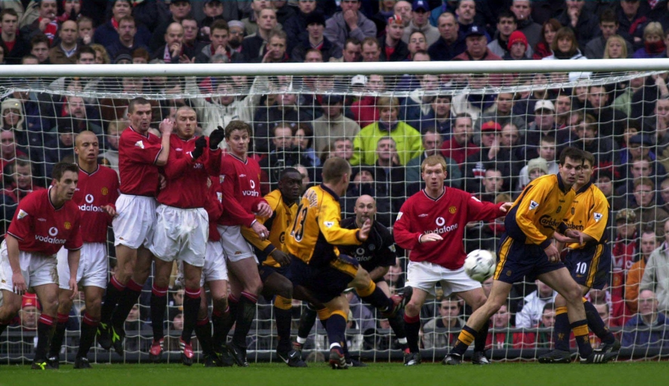 Murphy curls a free kick past Fabian Barthez in 2000