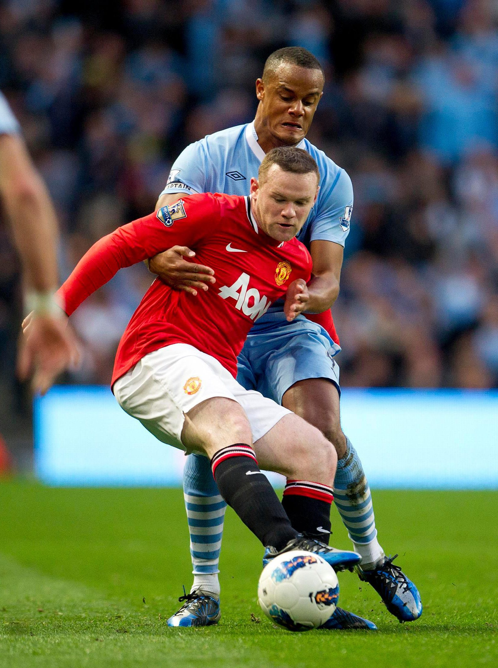 Kompany battles with Rooney for the ball