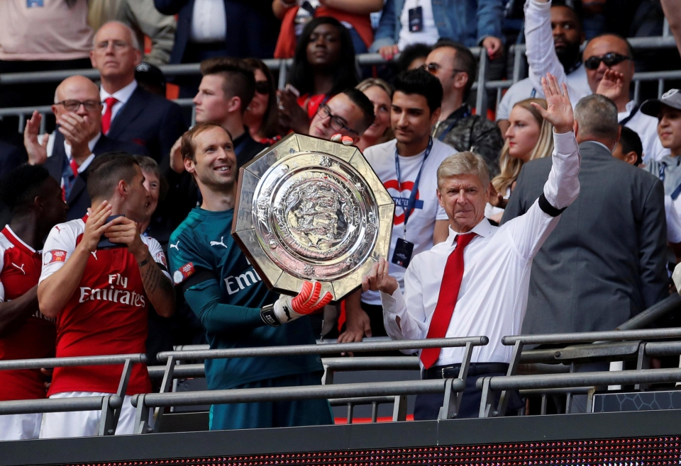 Arsene Wenger celebrates the community shield victory with shot-stopper Petr Cech