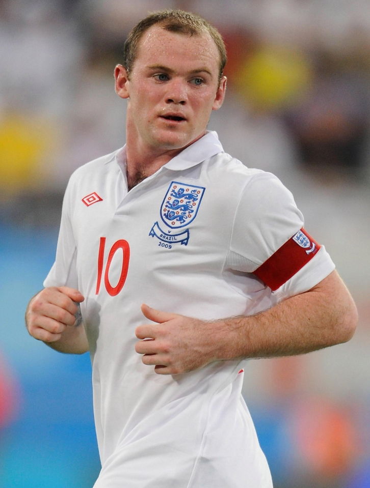 Wayne Rooney led the England team out as captain 22 times