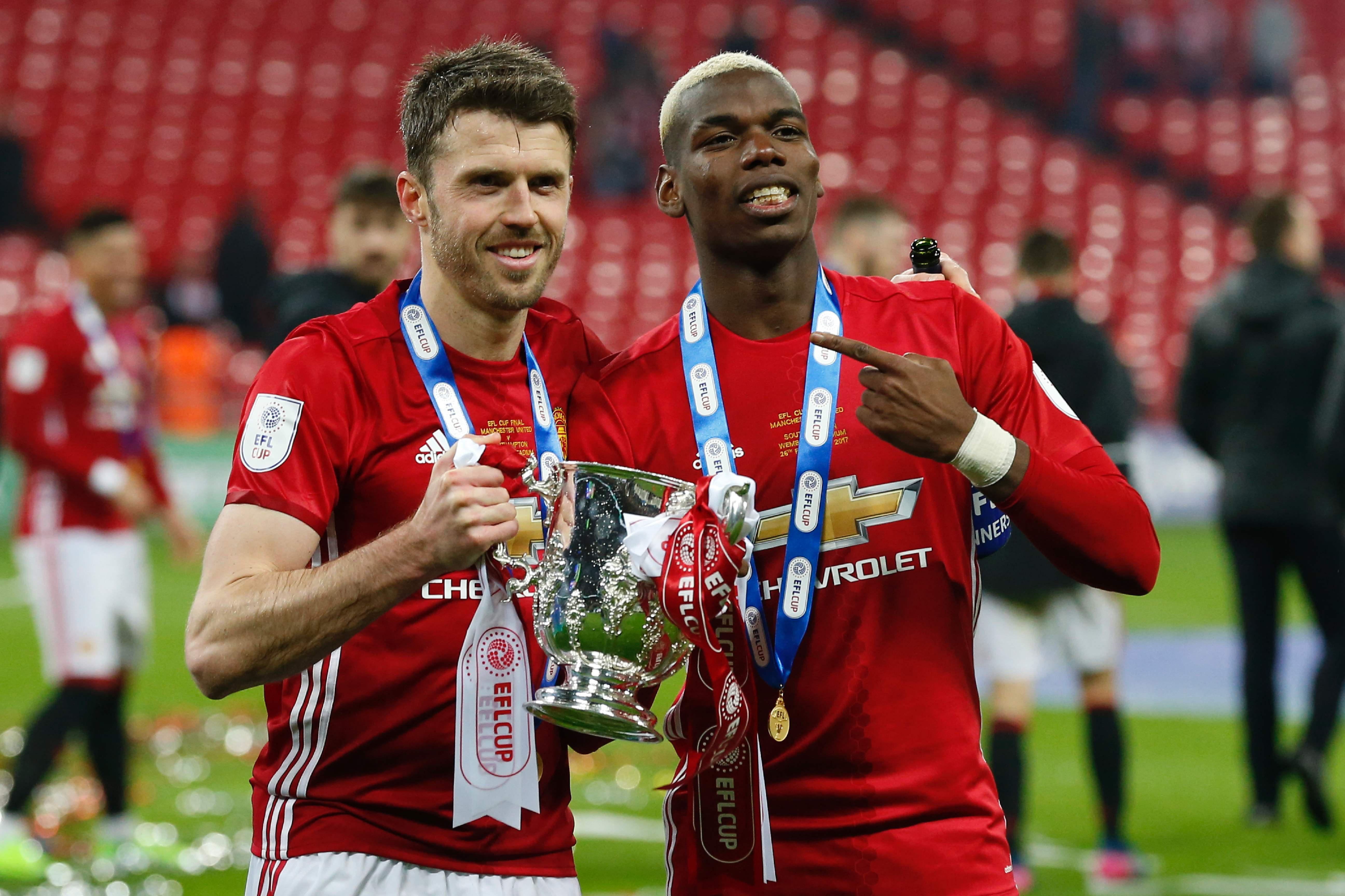 Pogba and Carrick celebrate winning the EFL Cup last season