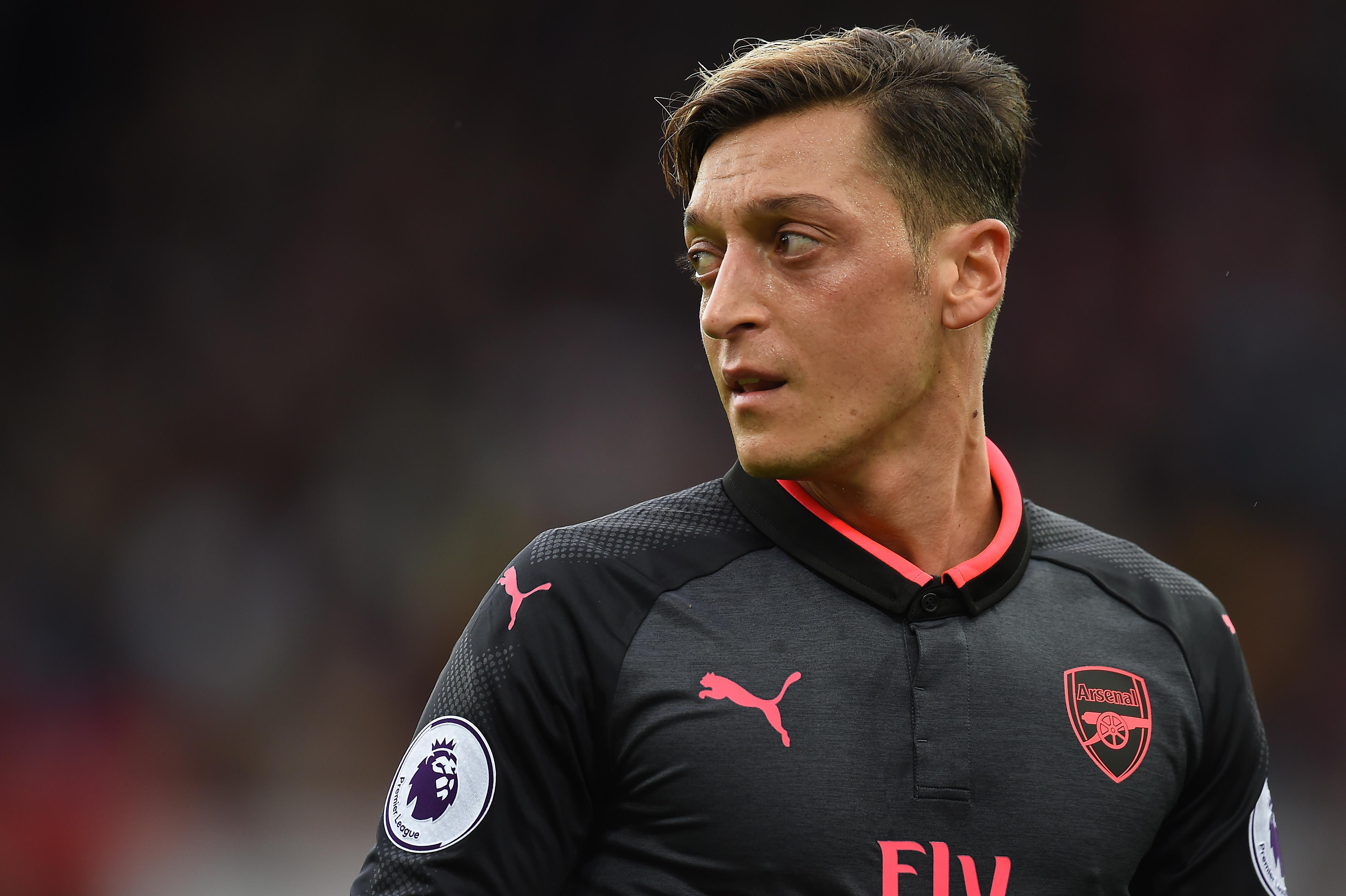 Mesut Ozil has told Arsenal's legends to shut up and start supporting the club