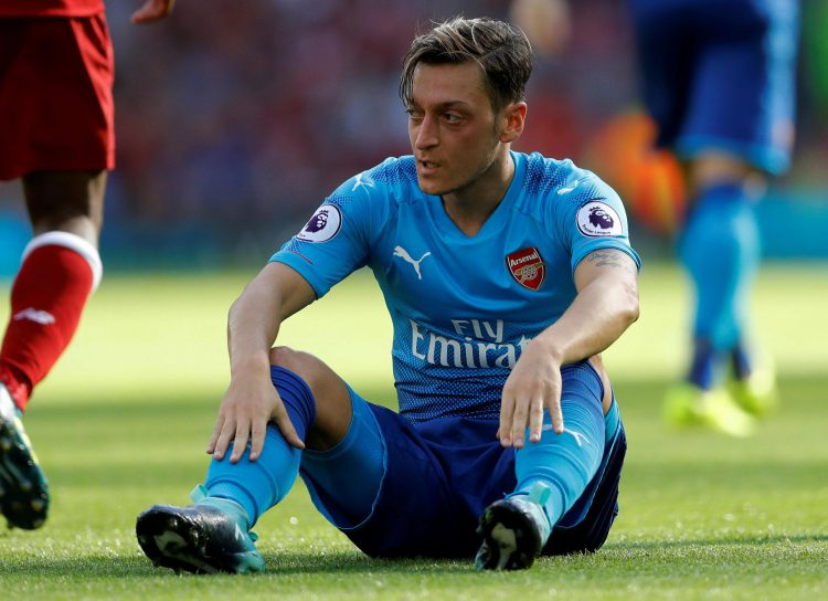 Sitting down while the game is going on is maverick even by Mesut's standards