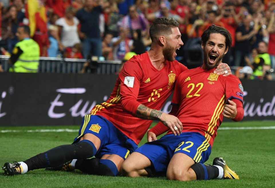 Isco, right, celebrates his first-half double with Spain team-mate Sergio Ramos