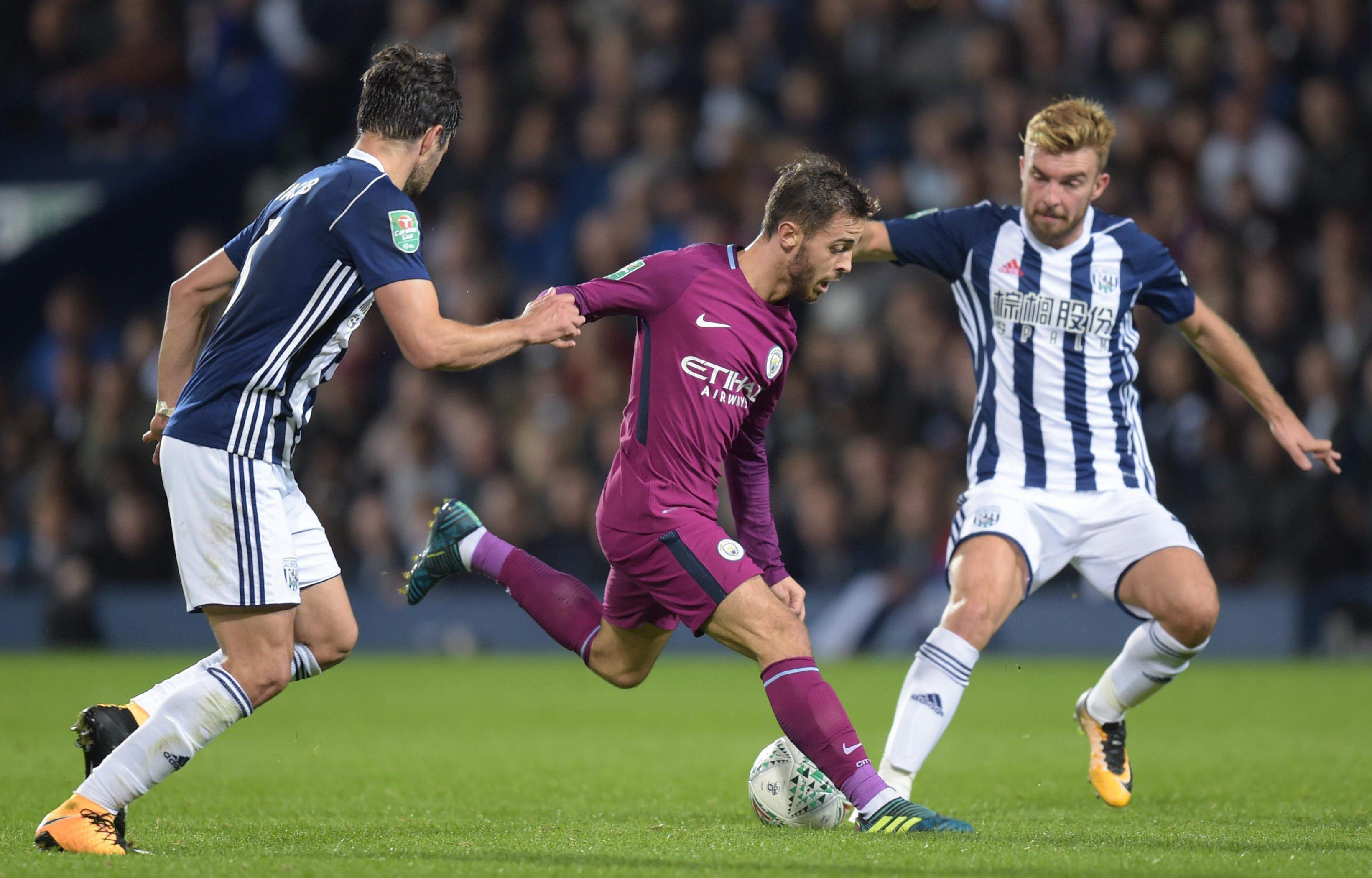 Bernardo Silva powers in an effort watched by West Brom duo Claudio Yacob and James Morrison
