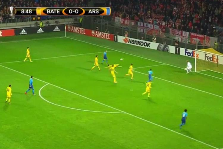 As he receives the ball back from Giroud, he glides into the BATE box and crosses to an open Walcott