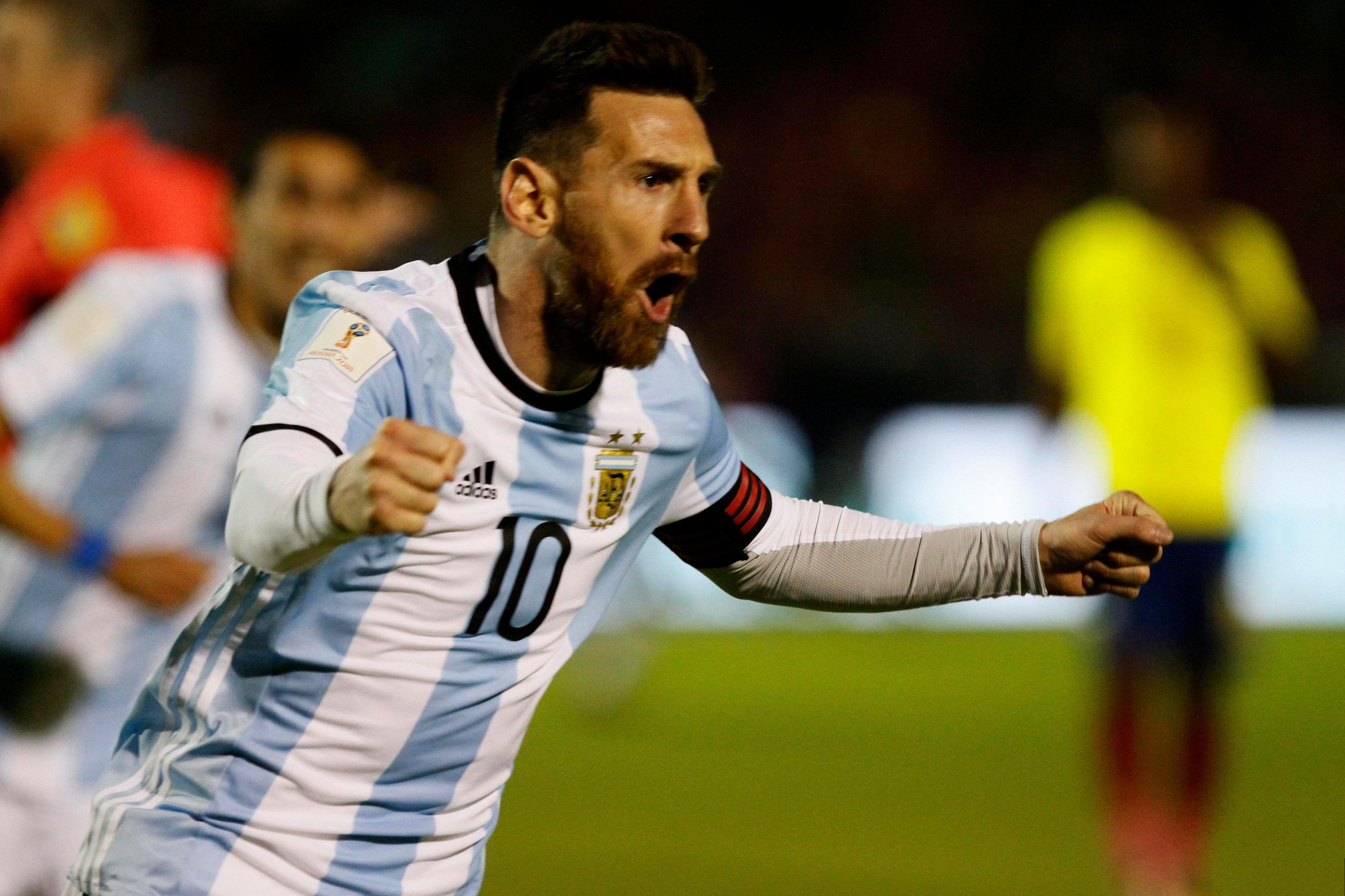 Lionel Messi scored a hat-trick to book Argentina's spot at next year's World Cup