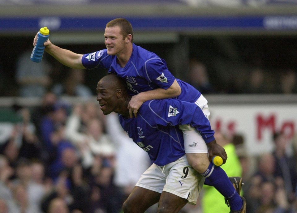 Rooney gets a piggy back from Kevin Campbell