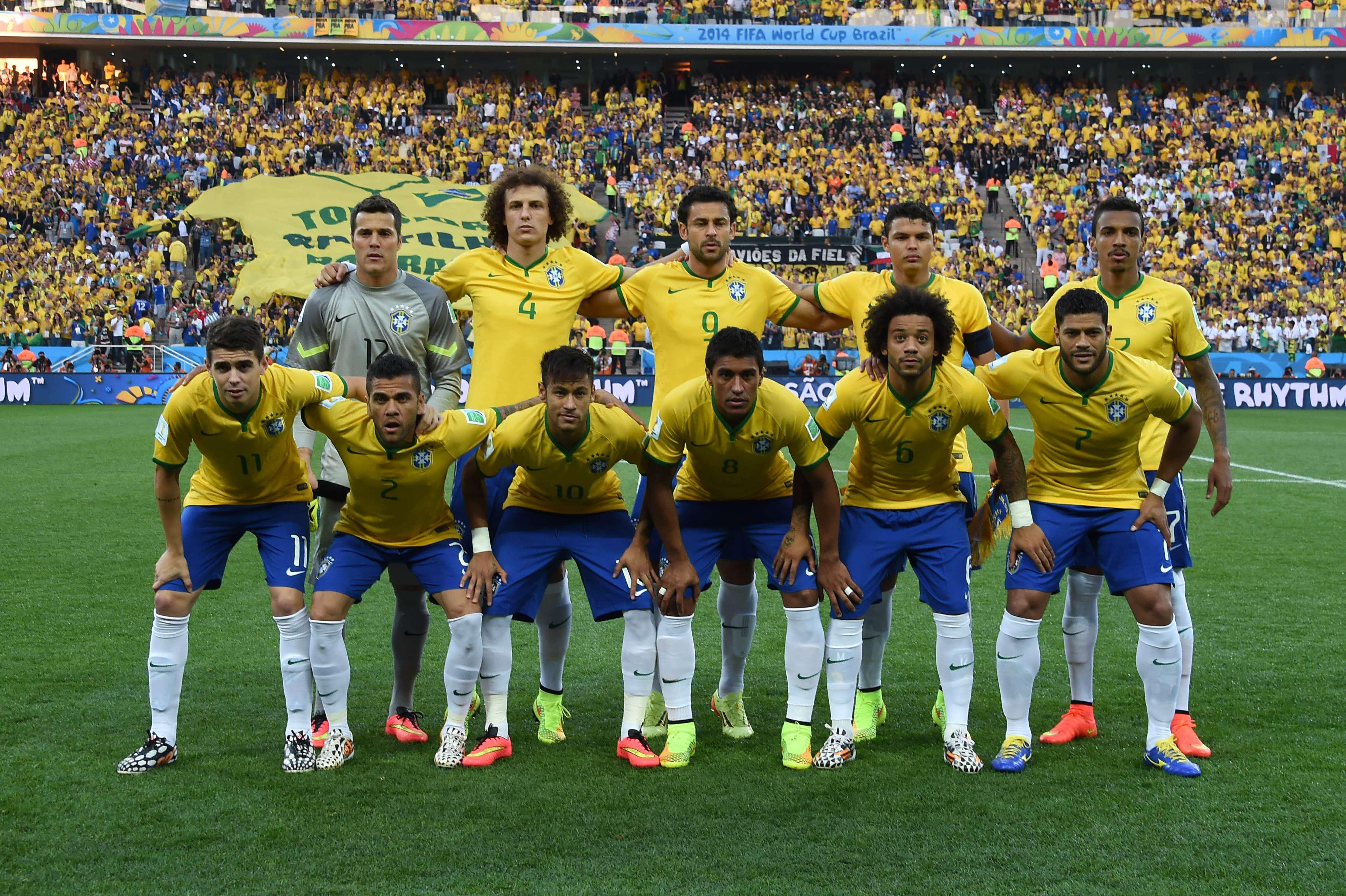 Alves and Gustavo line up together for Brazil at the last World Cup