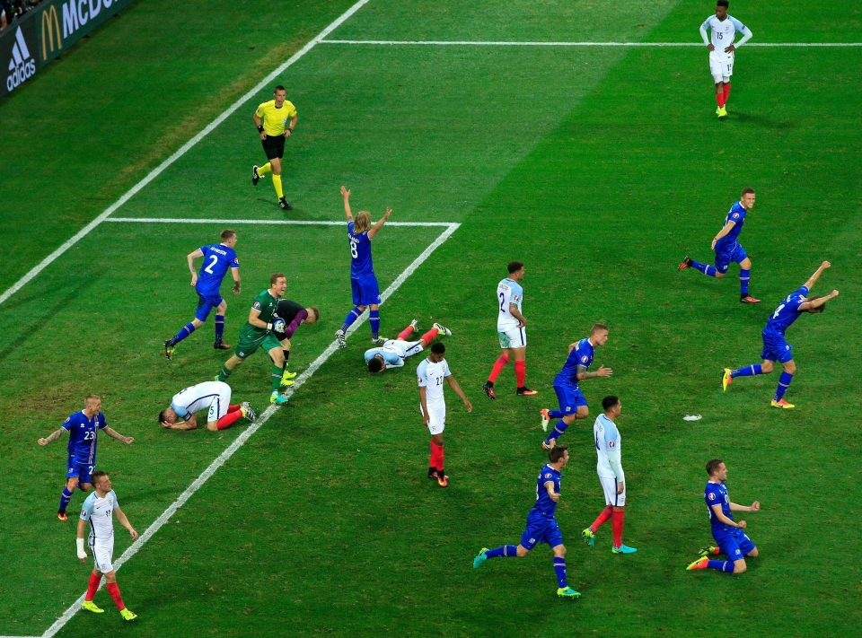 Iceland celebrate their historic win over England that ended the reign of Roy Hodgson