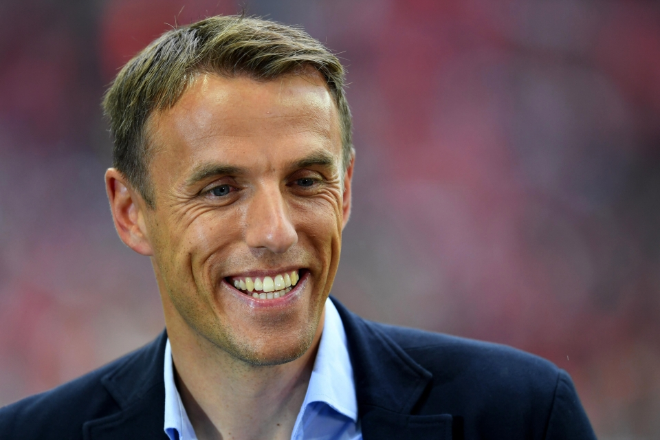 Phil Neville has declared he is interested in managing Everton
