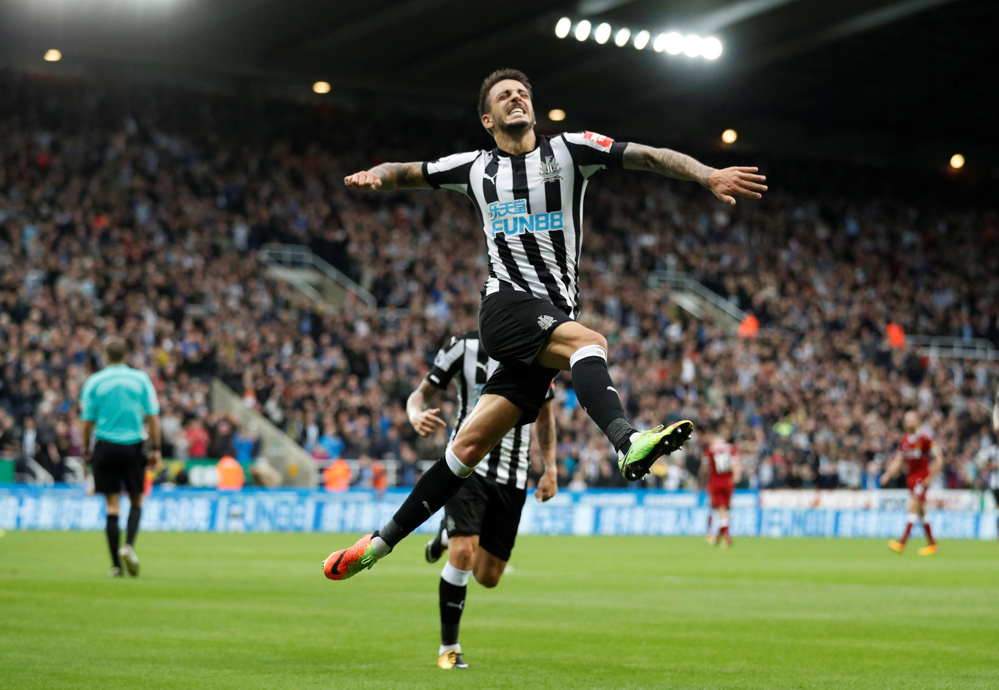 Joselu leaps in celebration after he scrambed in the equaliser for Newcastle
