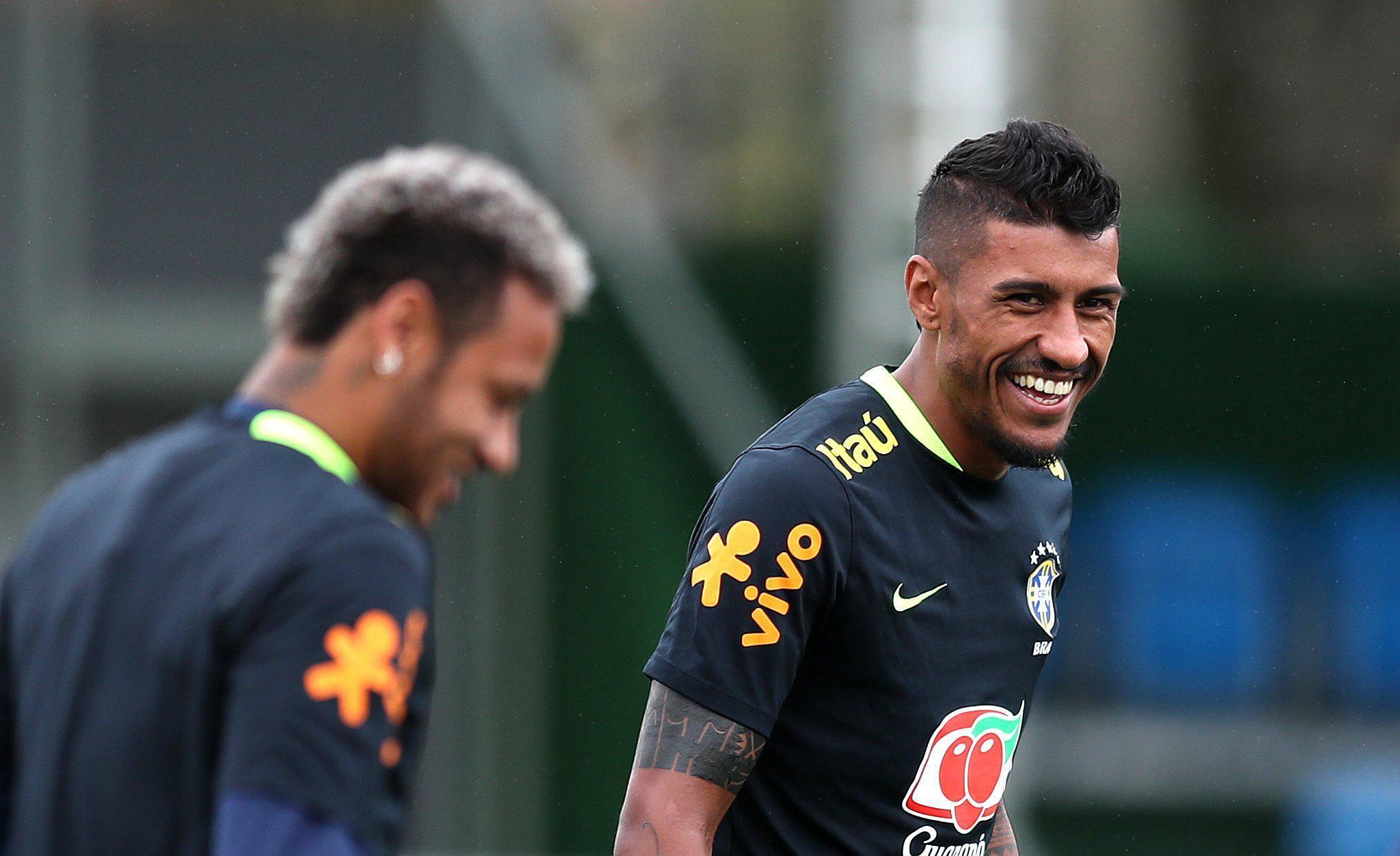 Neymar and Paulinho, having a laugh before Paulinho batters him