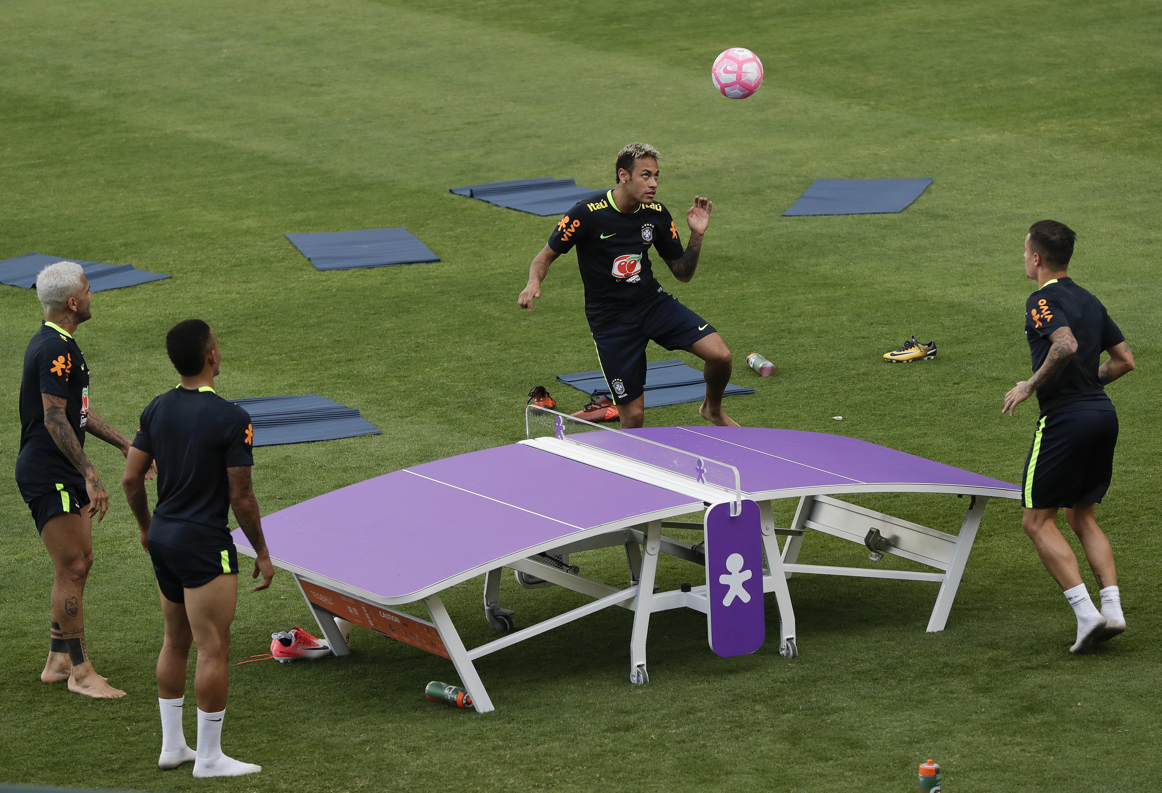 Brazil's Neymar,, practices with teammates Philippe Coutinho, Dani Alves, and Gabriel Jesus, during a training session in preparation for an upcoming World Cup qualifying match, in Sao Paulo, Brazil