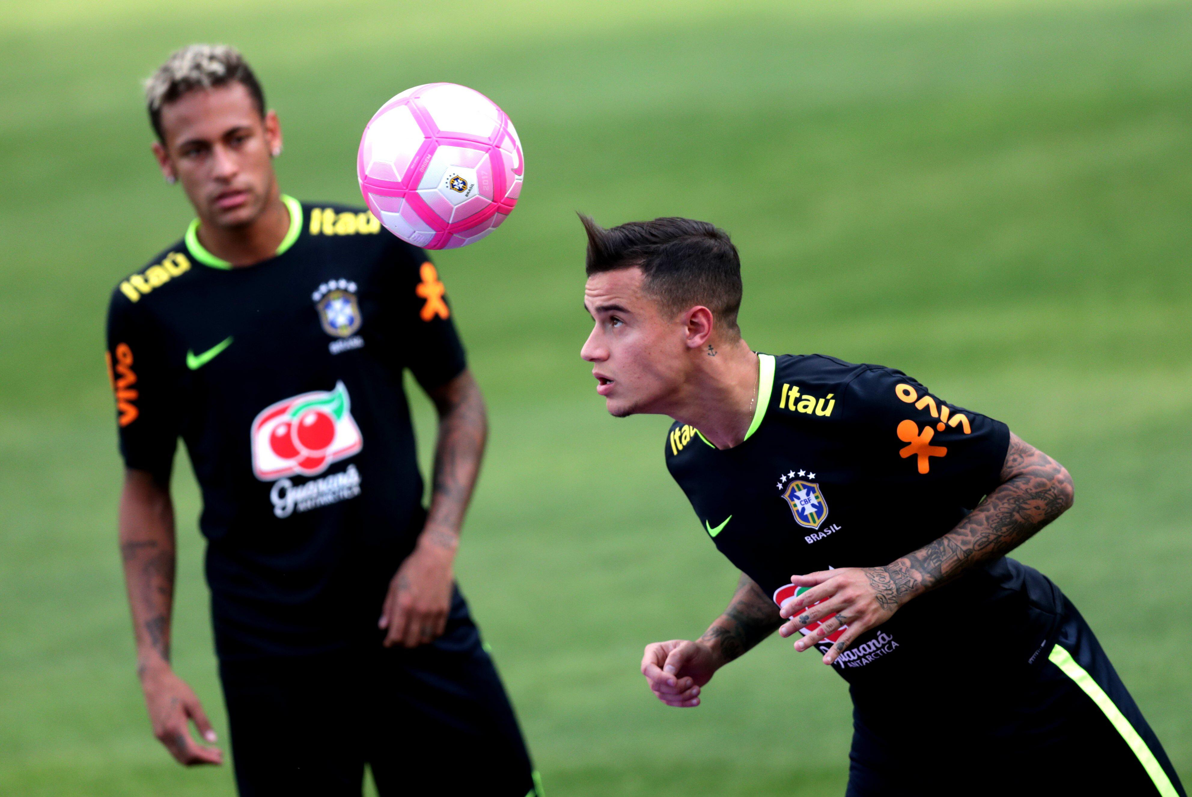 Philippe Coutinho lets the ball mess up his hair during the training session