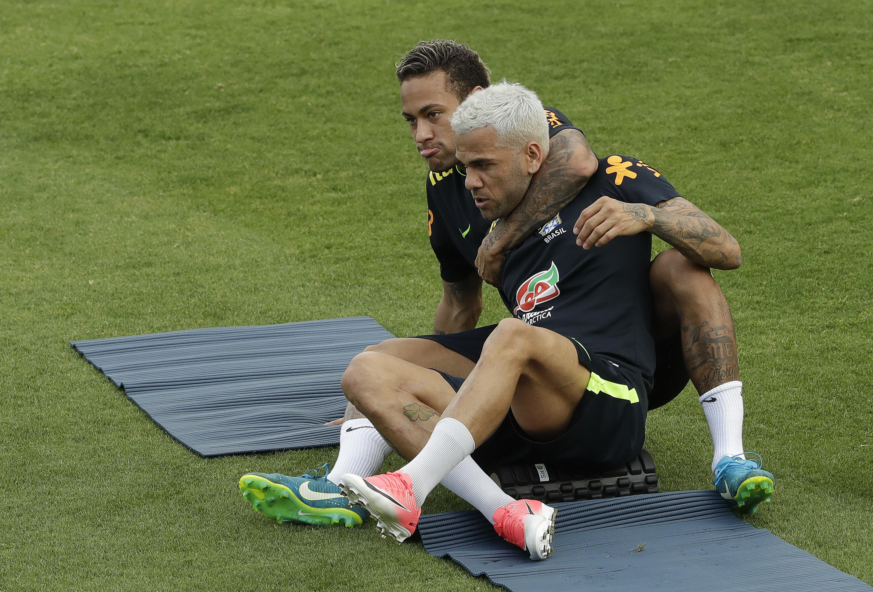 Brazil's Neymar puts Dani Alves in a headlock during a training session in Brazil. the PSG teammates have a great rapport