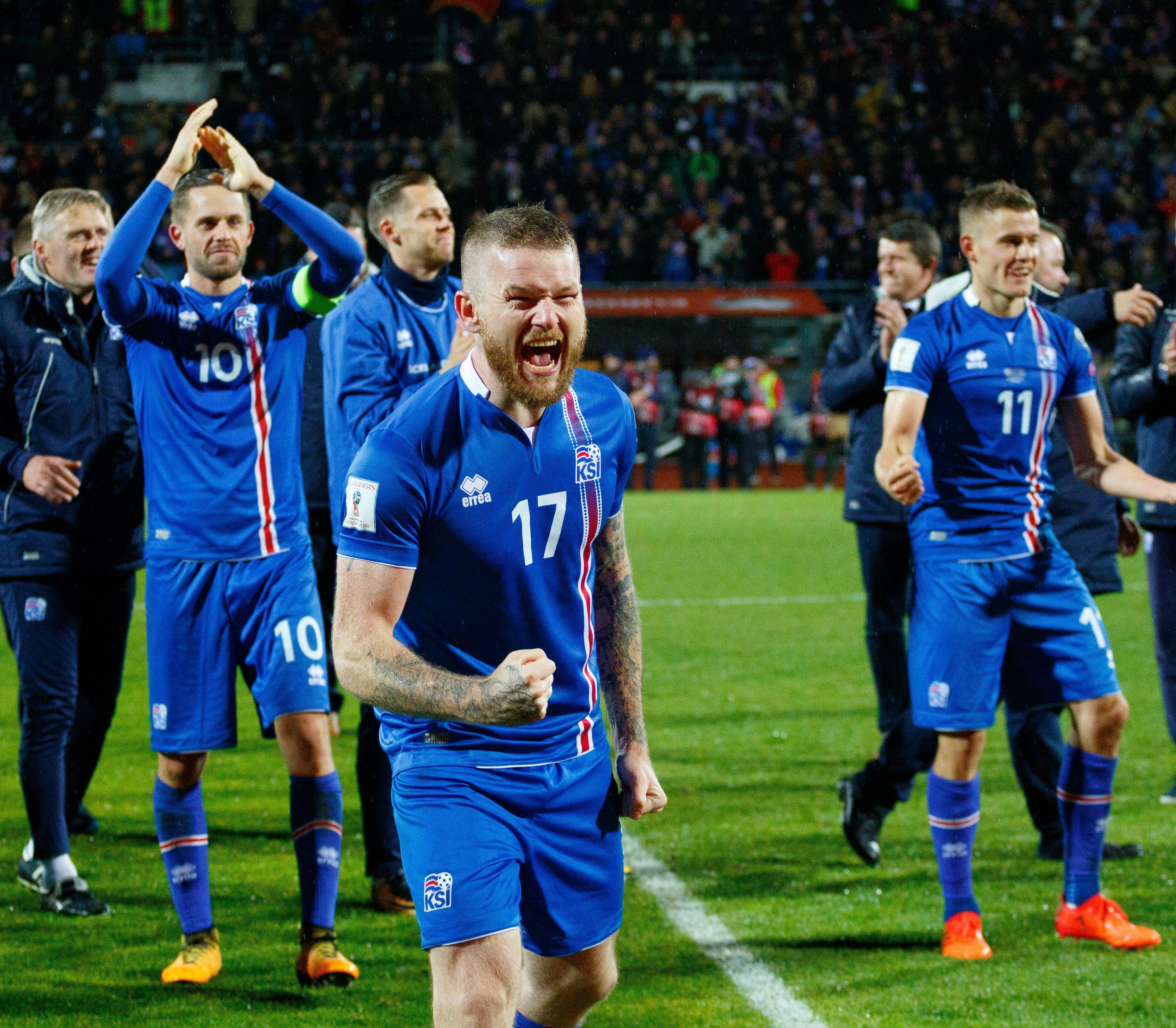 Iceland captain Aron Einar Gunnarsson celebrates their historic victory