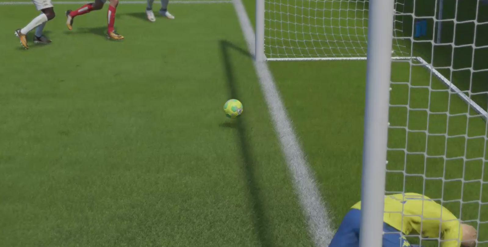 It then rebounds off an invisible wall and sits out of the goal mouth