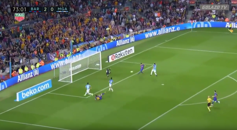 Suarez makes contact in front of a partially empty goal