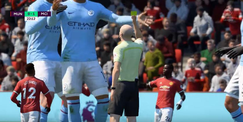 The ref hands out a yellow card to a giant City player