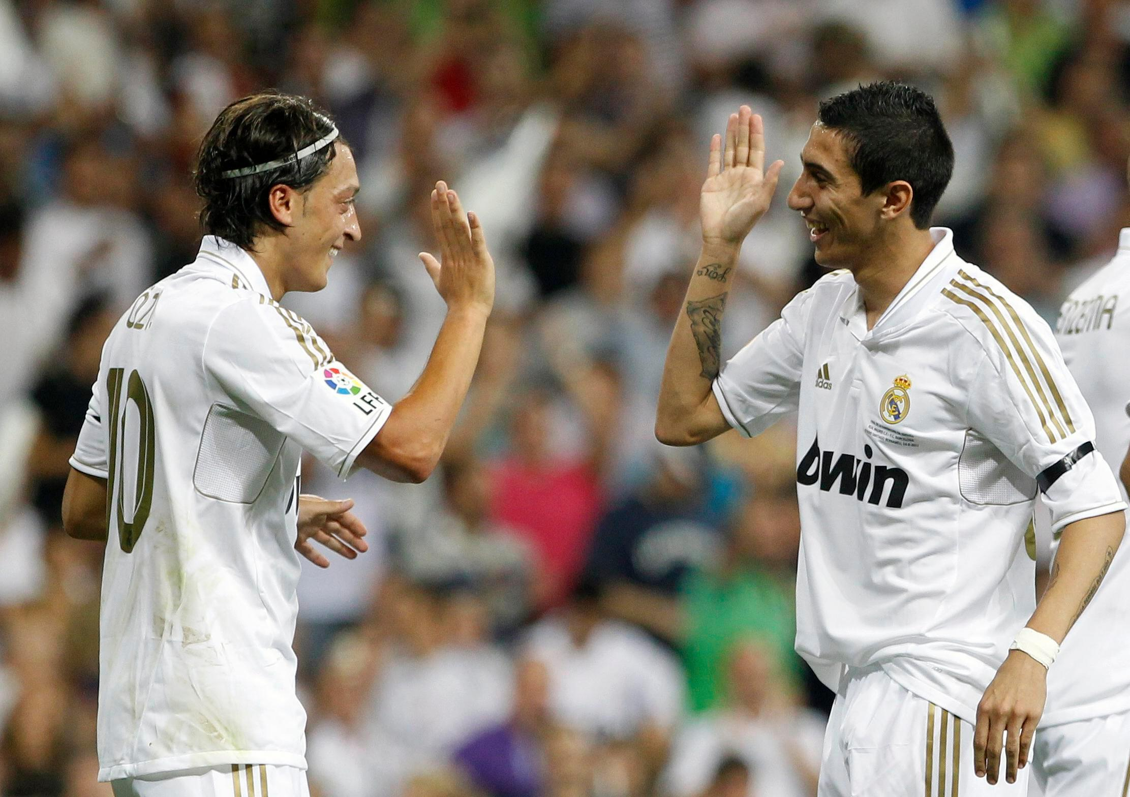 Mesut Ozil and Angel Di Maria would be hate figures at Real Madrid with Barcelona move