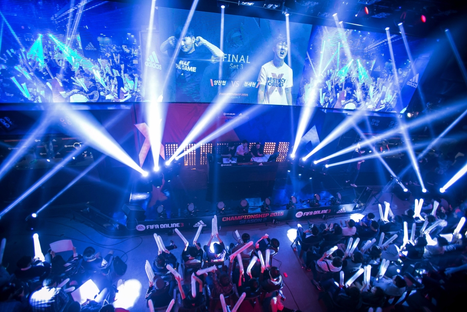 Fans cheer as they watch the final round of the EA Sports FIFA Online Championship at the Nexon Co. e-Sports Stadium in Seoul, South Korea