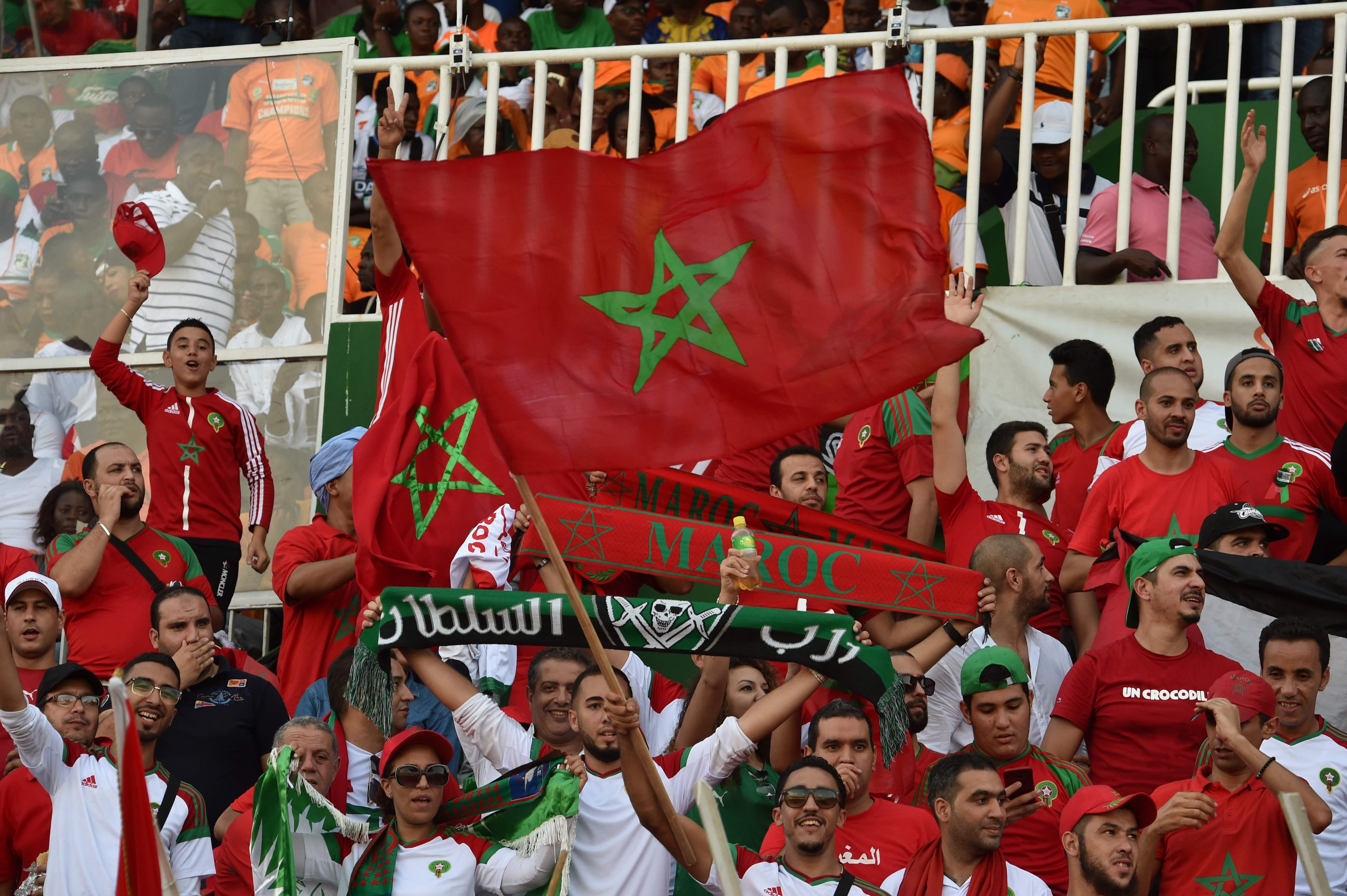Morocco fans celebrate beating Ivory Coast