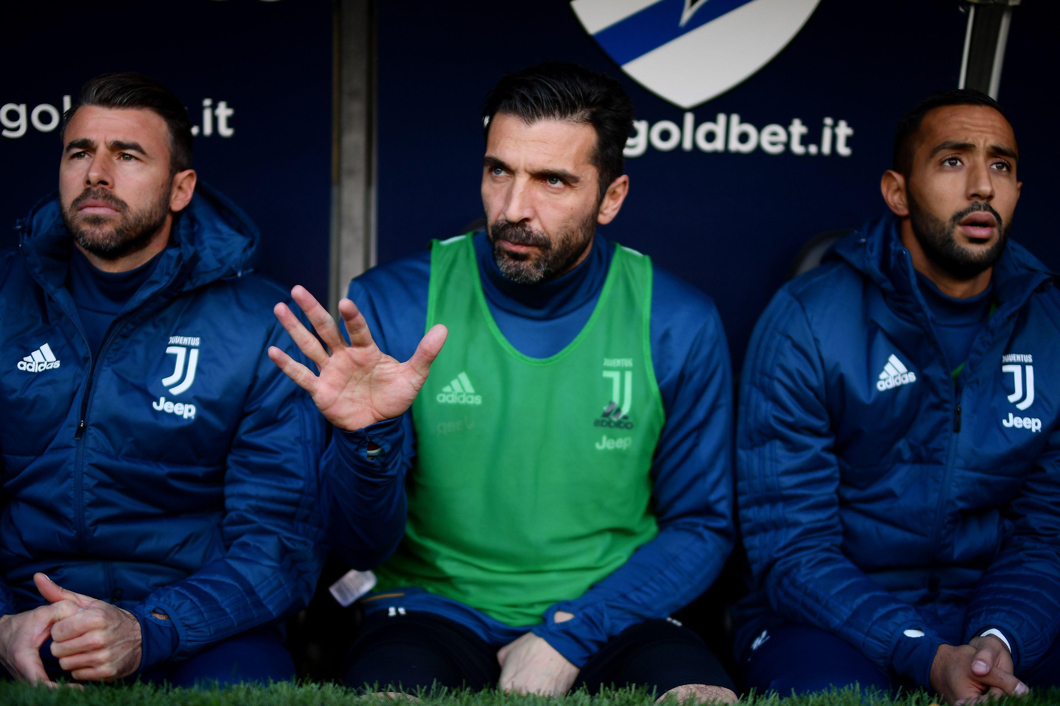 An unfamiliar sight of Buffon warming a bench