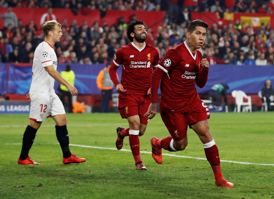 Roberto Firmino and Mohamed Salah celebrate Liverpool's first goal