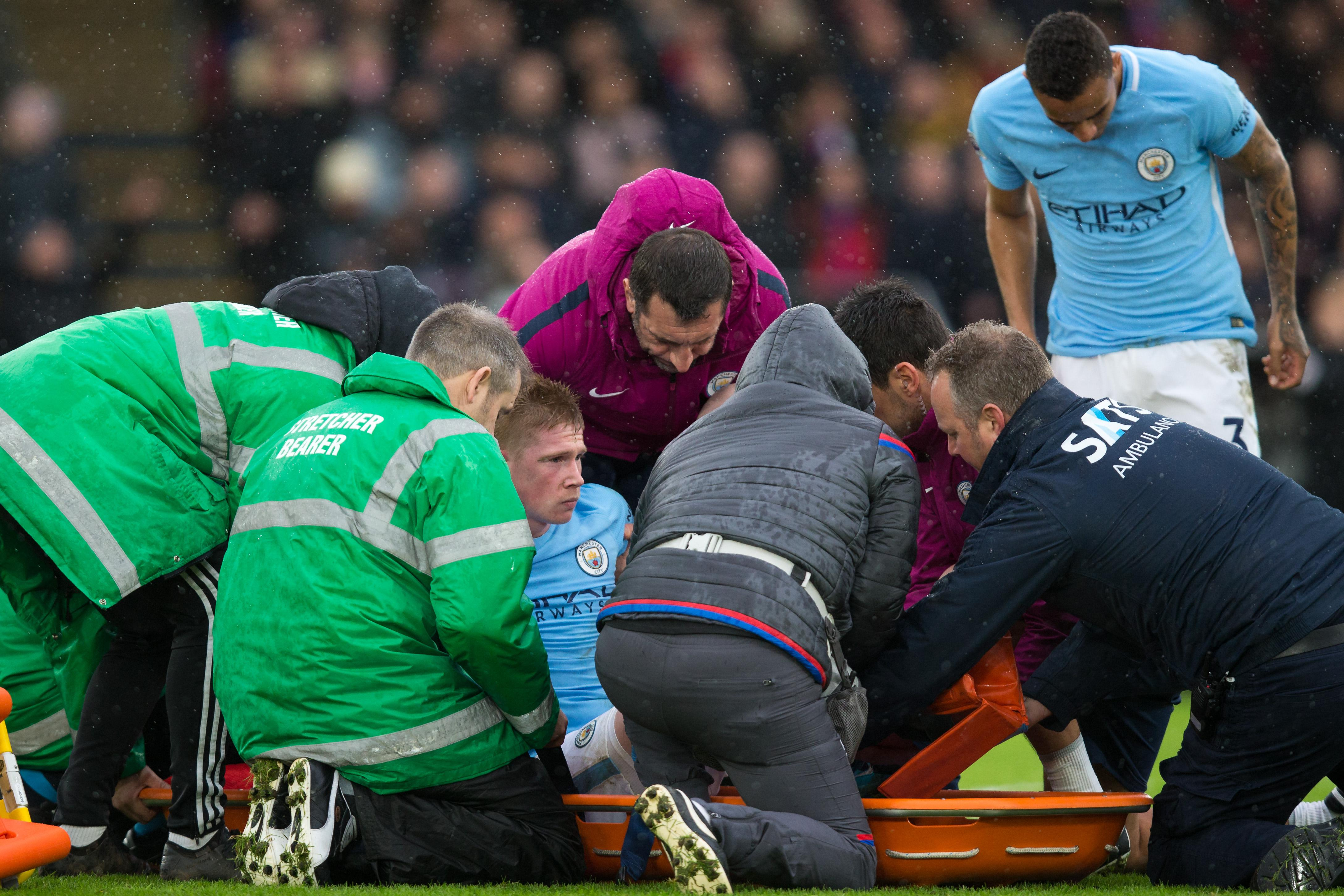 Medical staff put him onto a stretcher