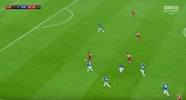 He dribbles past Ashley Williams and is through on goal