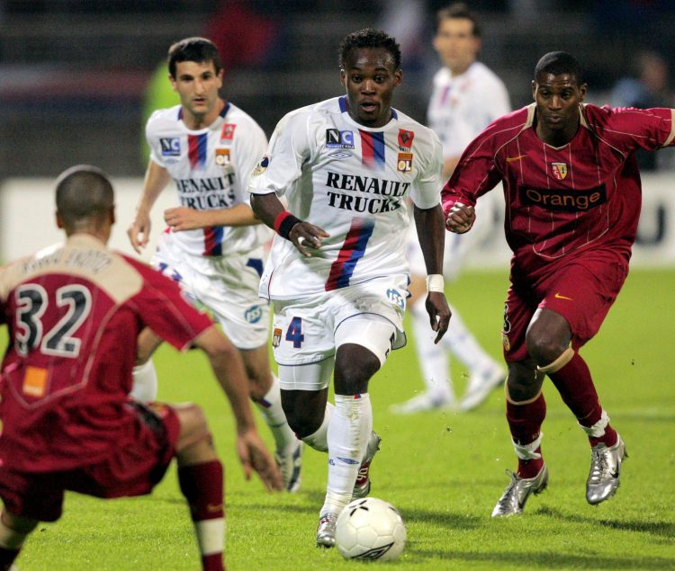 Essien leading Lyon to one of their seven Ligue 1 titles in the 2000s