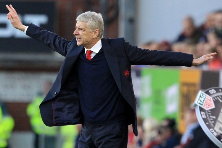 Wenger doing his best angel impression