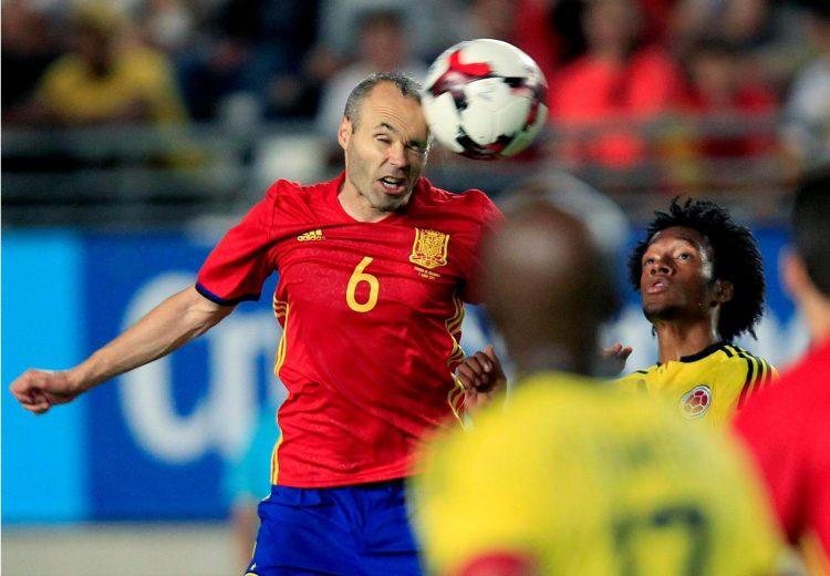 A rare Iniesta header