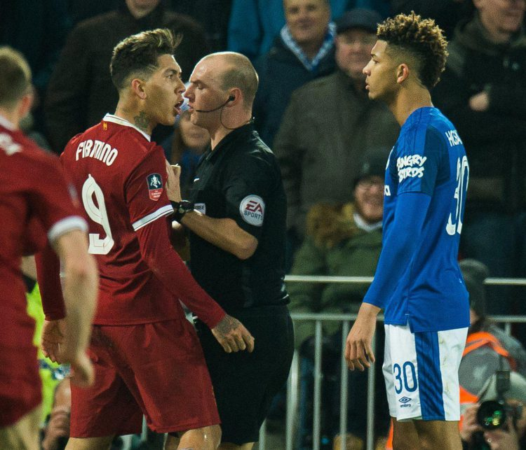 Holgate accused Firmino of a racial slur during this encounter