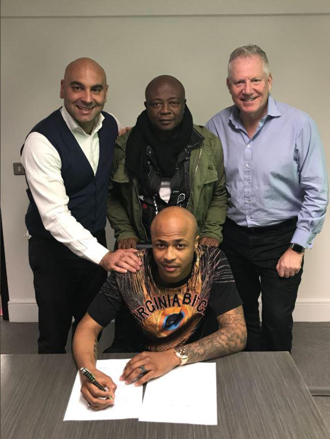 Ayew signing on the dotted line
