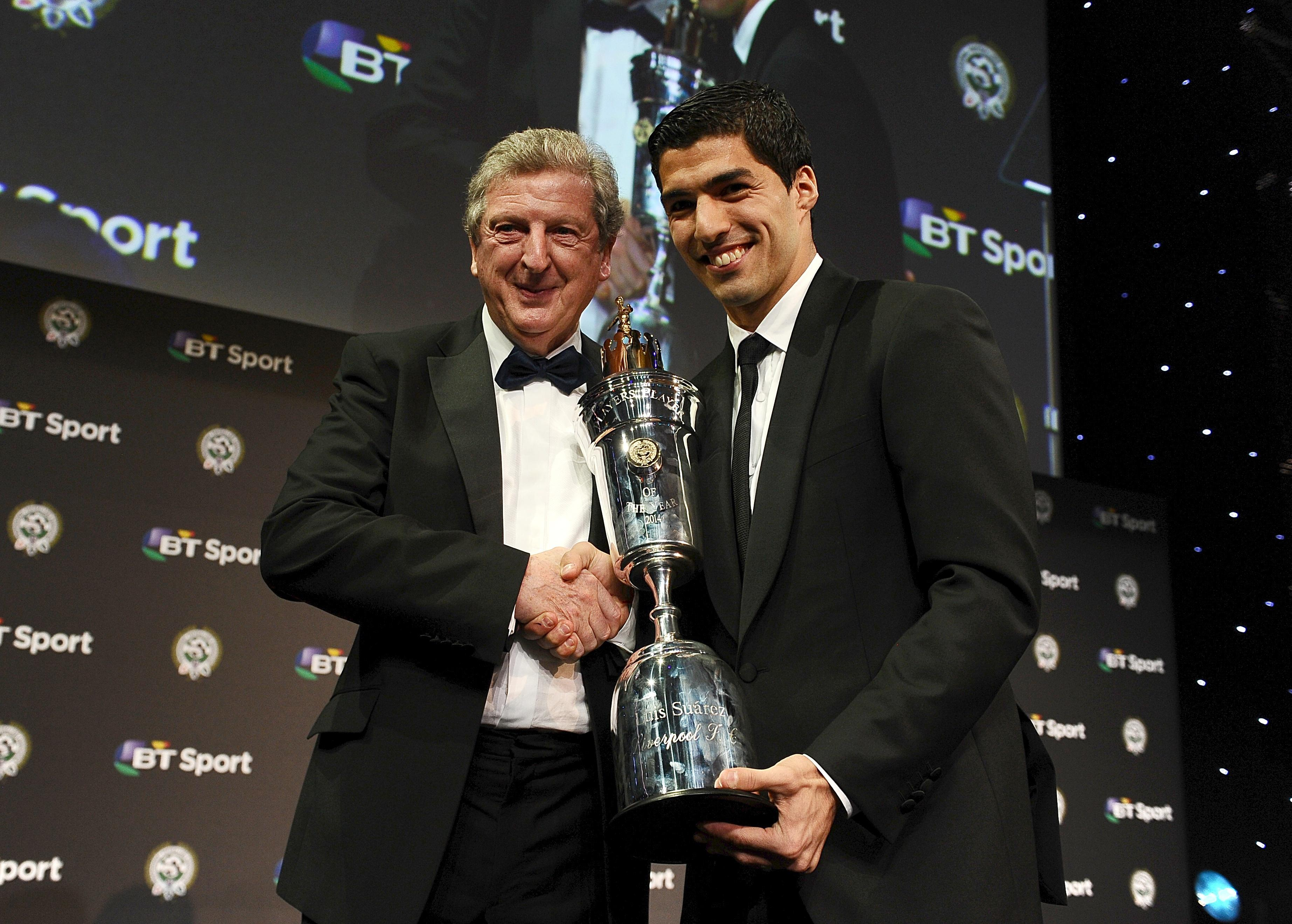Suarez collects the 2013/14 PFA Player of the Year award from his idol