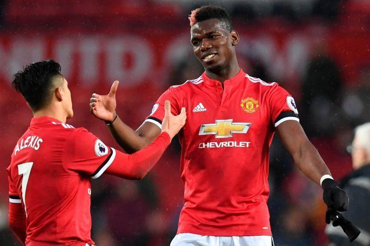 Pogba congratulating his fellow defender